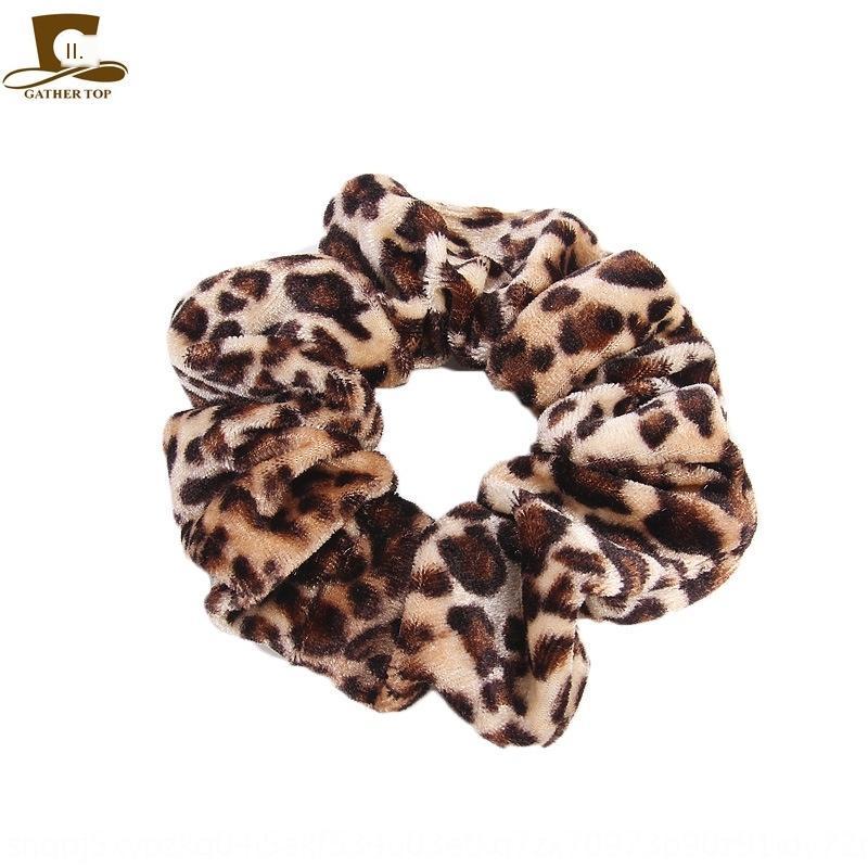 Otoño invierno de terciopelo de oro banda Sirviendo franela estampado leopardo banda de la bola de pelo de bolsillo medio pelo tocado de flores