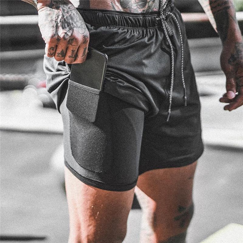 Pantalones cortos ocasionales de los hombres 2 en 1 Ejecución de entrenamiento Pantalones cortos de secado rápido Deporte gimnasios de culturismo incorporado en los bolsillos de los hombres cortos