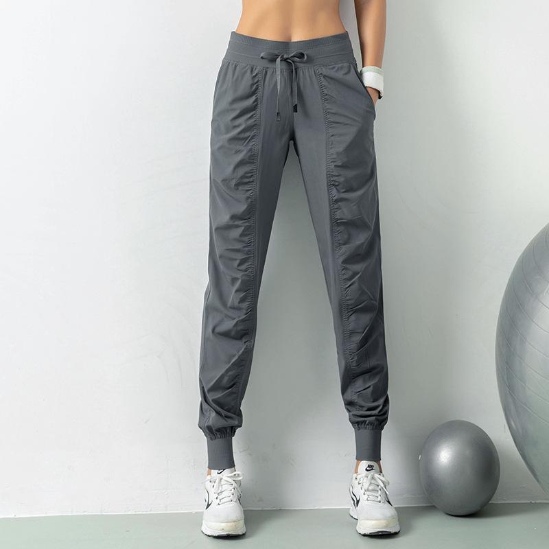 Фриволите Ткань Drawstring Бег Спорт Бегуны Женщины Quick Dry Athletic Gym Фитнес трениках с двумя боковыми карманами
