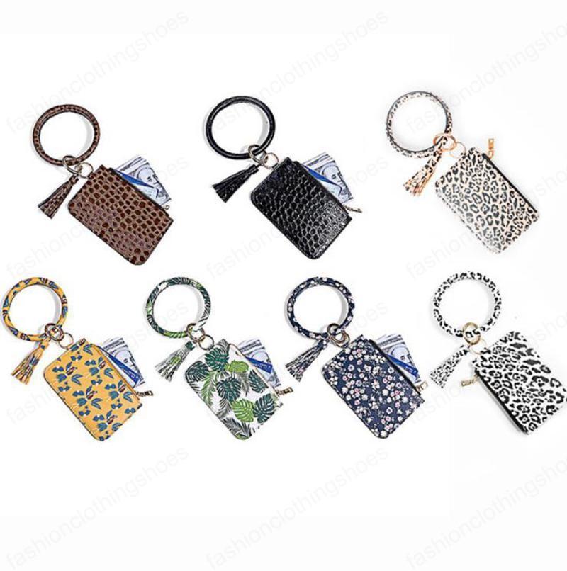 Bracciale Portafoglio del cinturino in pelle braccialetto Portachiavi PU Portachiavi attaccatura del supporto di carta moneta del sacchetto borsa del telefono delle ragazze delle donne Gioielli 7 disegni OWA749