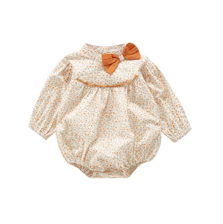 الملابس INS BABY الاطفال جولة كم طويل الياقة مع القوس زهرة طباعة رومبير 100٪ القطن الطفل تسلق الربيع الخريف فتاة رائعة رومبير