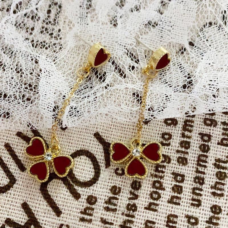 S925 silber und Liebe Blume Klappe Frauen koreanischen Sinn Nadel und weise personifizierte vierblättrige Ohrringe elegante erweiterte Artohrringe ZsFNg
