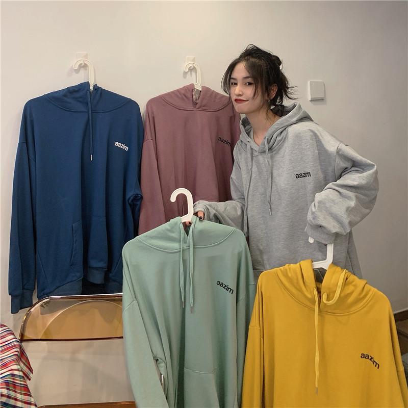 suéteres de diseño vendedor caliente para mujer del todo-fósforo de manga larga de color sólido suéteres mujeres 2020 nueva caída sueltos chaquetas con capucha de la moda de los estudiantes
