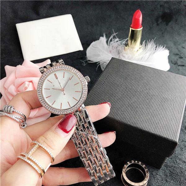 Femmes de l'homme de 37.7MM amant quartz analogique montre-bracelet Horloge Hommes Montres MK Luxe Montres de