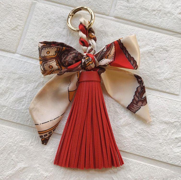 Donne portachiavi portachiavi in tessuto a mano in tessuto a mano in pelle di seta in pelle nappa sacchetto ciondolo gioielli coreano moda auto portachiavi all'ingrosso