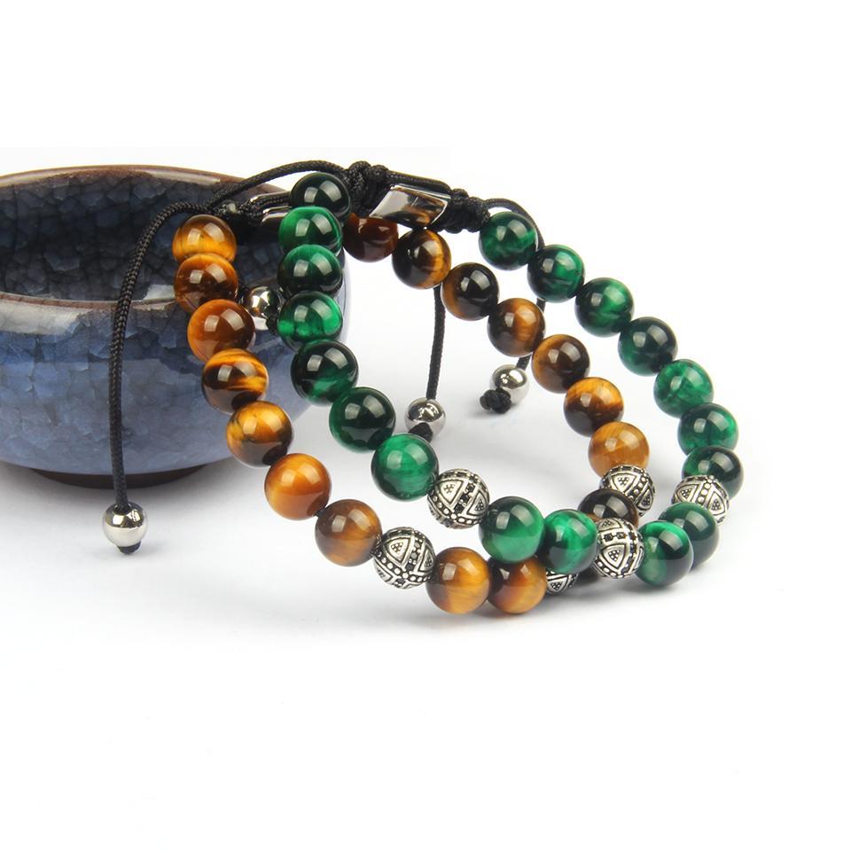 مجوهرات تصميم الأزياء الدينية الجملة 10pcs / الكثير 8MM الطبيعية النمر الخرز حجر العين مع الأسود تشيكوسلوفاكيا الصليب سوار للهدايا