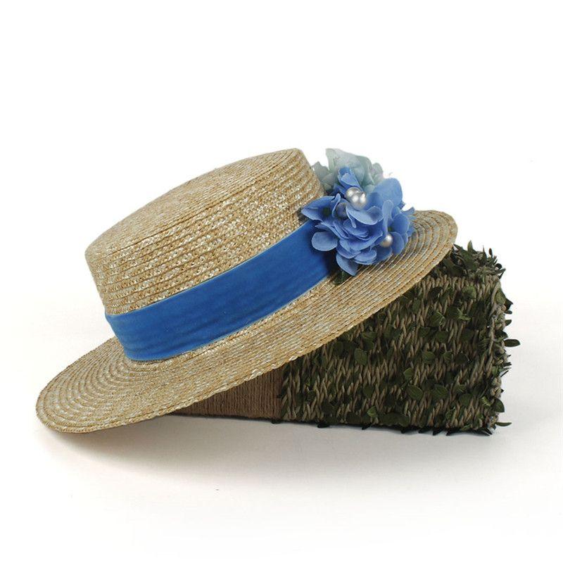 100% de trigo paja de las mujeres de ala ancha sombrero para el sol Señora de moda de verano plana Sunbonnet navegante playa sombrero de la flor azul con