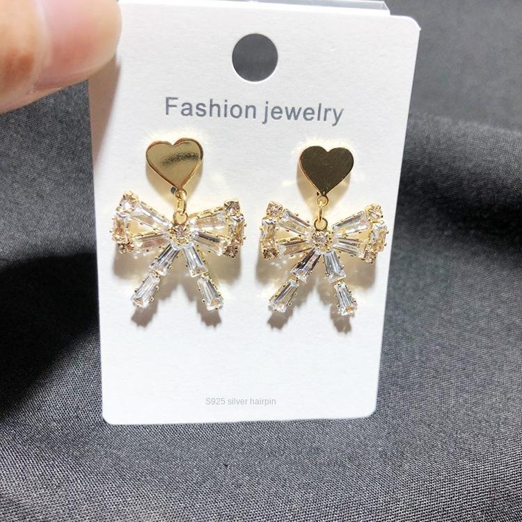 XUpeW Yiwu jóias borboleta e brincos elegantes das mulheres coreanas S925 brincos arco de agulha de prata