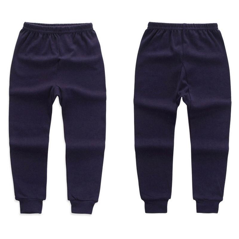 Pantalones nuevo otoño del resorte de los niños del color sólido para Niños Niñas Inicio desgaste suave algodón Pantalones largos de los cabritos del bebé niños elásticos de las polainas