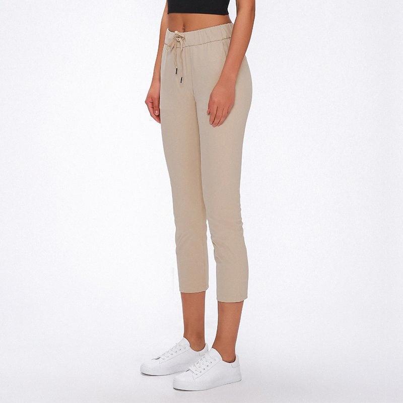 Doux nu-sensation Tissu Yoga capris entraînement Pantalon sport Femmes taille coulissée Fitness Course à pied avec Sweatpants Two Side Pocket # de