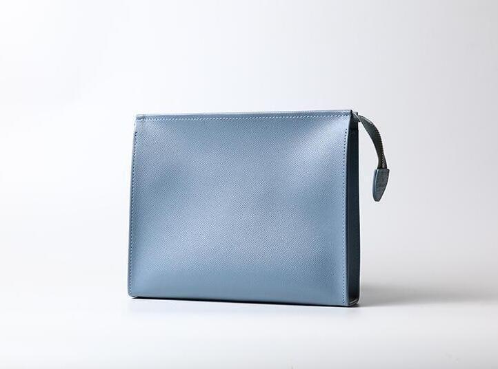 مصمم الرجال الجديد سفر أدوات الزينة الحقيبة 25 سم حماية ماكياج الفاصل النساء جلد طبيعي حقائب مستحضرات مضادة للماء للنساء