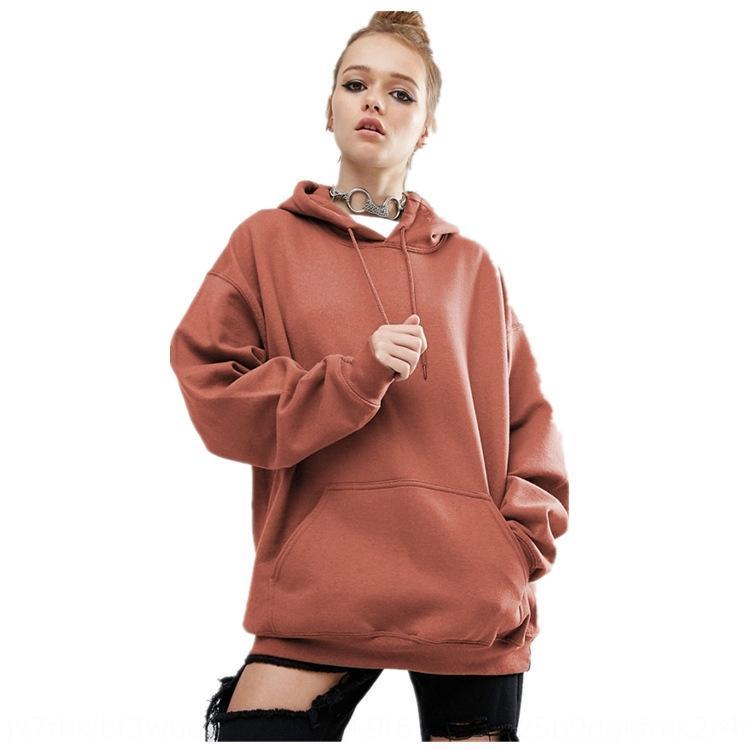 Automne et hiver Nouveau manches chauve-souris à capuchon lâche sport de couleur unie chandail pull vêtements pour femmes