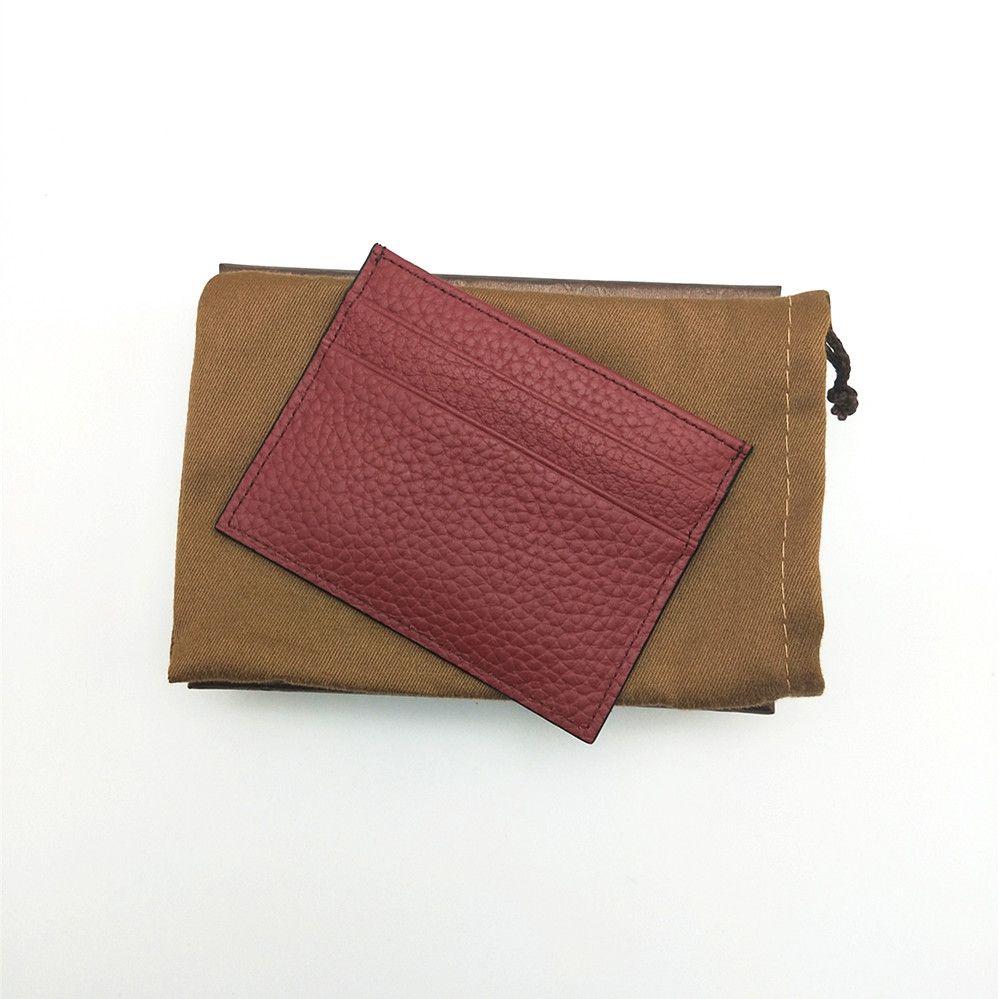 Nouveau célèbre classique en cuir véritable Hommes Femmes Carte de crédit Carte bancaire Titulaire Mini Petit portefeuille avec la boîte