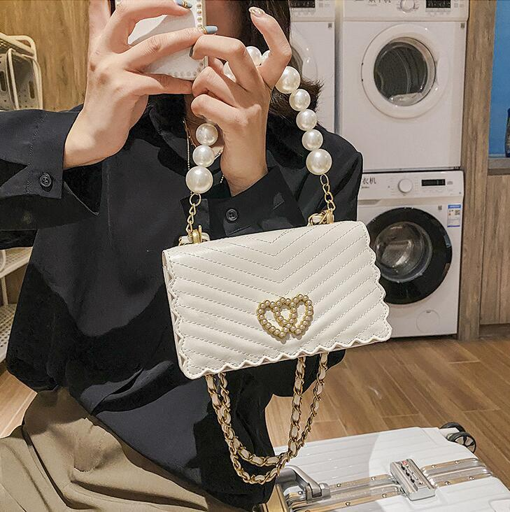 Factory wholesale women handbag new small fresh Pearl chain bags sweet ladies wavy leather shoulder bag new plaid leather fashion bag