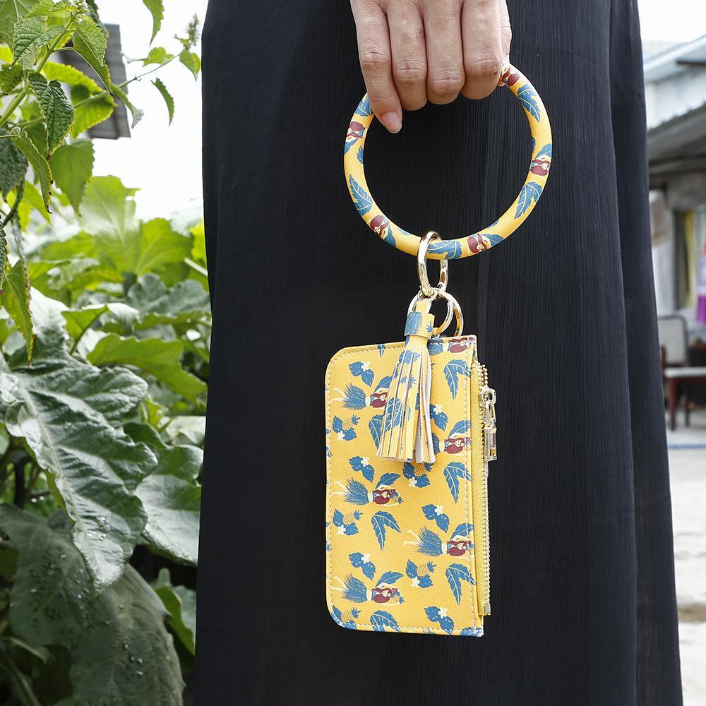 Nueva venta caliente llavero bolso de la tarjeta de la serpiente de las mujeres de los hombres la carpeta del leopardo PU de la borla de la moda llavero Kabaw pulsera de la joyería