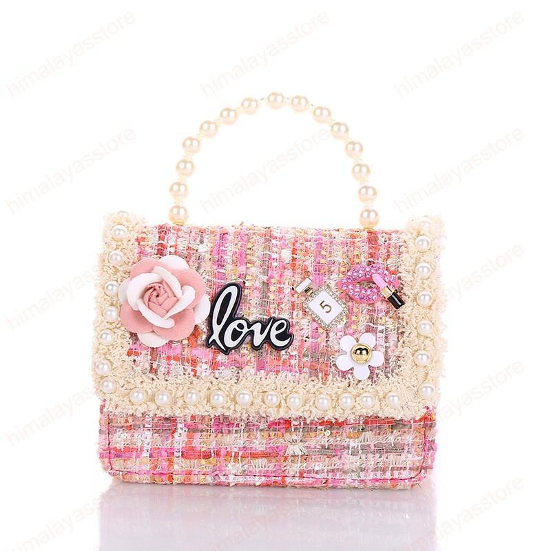 Monederos y bolsos de niños 2,020 linda carpeta de la moneda niñas Pequeña caja de la bolsa de partido del bebé del monedero del bolso de mano Kid perla bolsa de mensajero de regalo