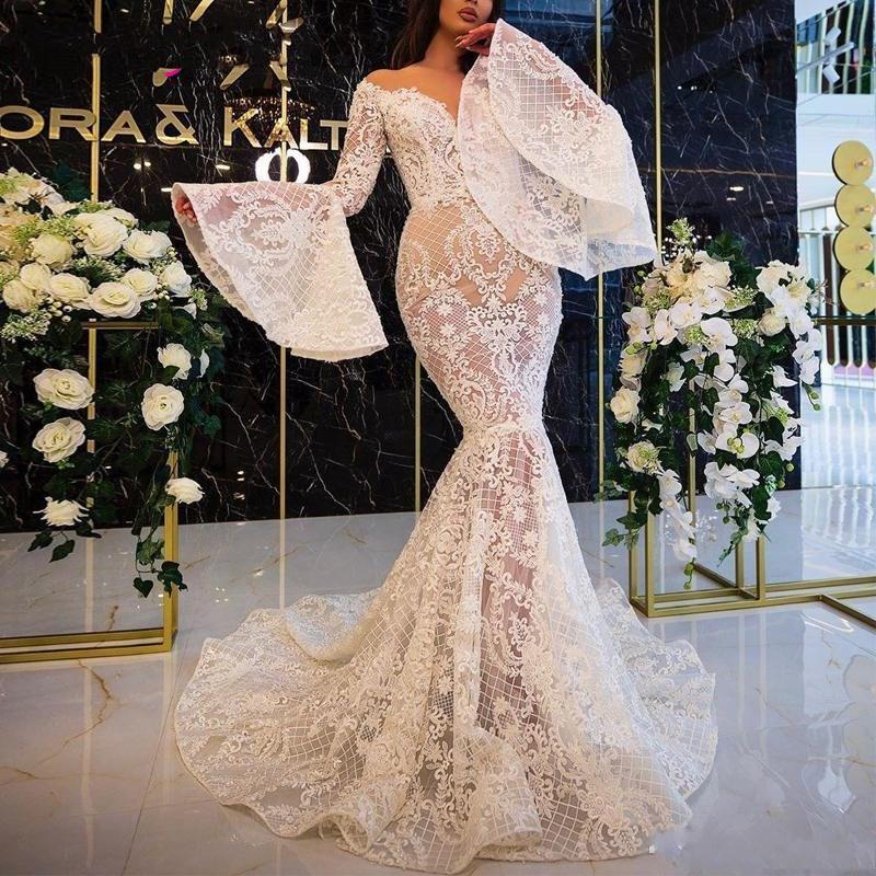 See Through кружево Русалка Свадебные платья Sheer шеи Flare Длинные рукава Дубай африканских Свадебные платья с помощью кнопки Назад Sexy Vintage Свадебная одежда