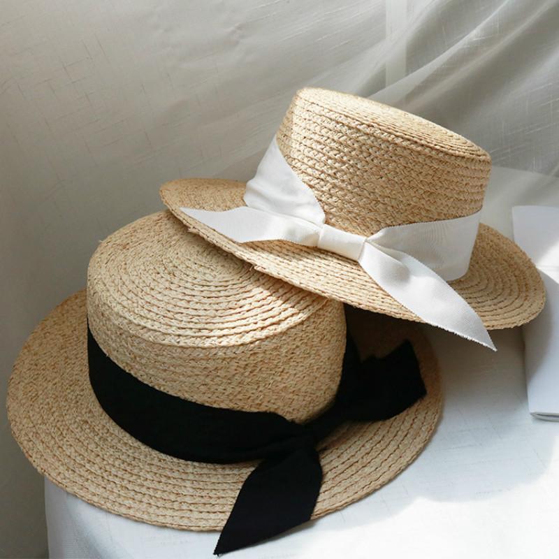 Nouvelle façon simple les femmes Summer Beach raphia ruban noir chapeau blanc arc Tempérament dessus plat chapeaux de paille mer Femmes plage Hat