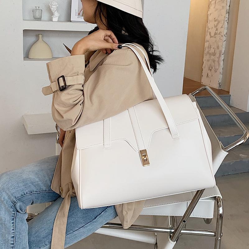 Düz renk Büyük Tote çanta 2020 Moda Yeni Yüksek kaliteli PU Deri Kadın Tasarımcı Çanta Seyahat Yüksek kapasiteli Omuz Çantaları