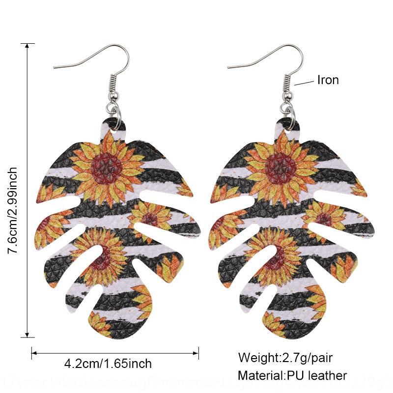 Nuevo estilo bohemio de doble cara Pu impreso en forma de hoja de cuero de girasol y pendientes de cuero