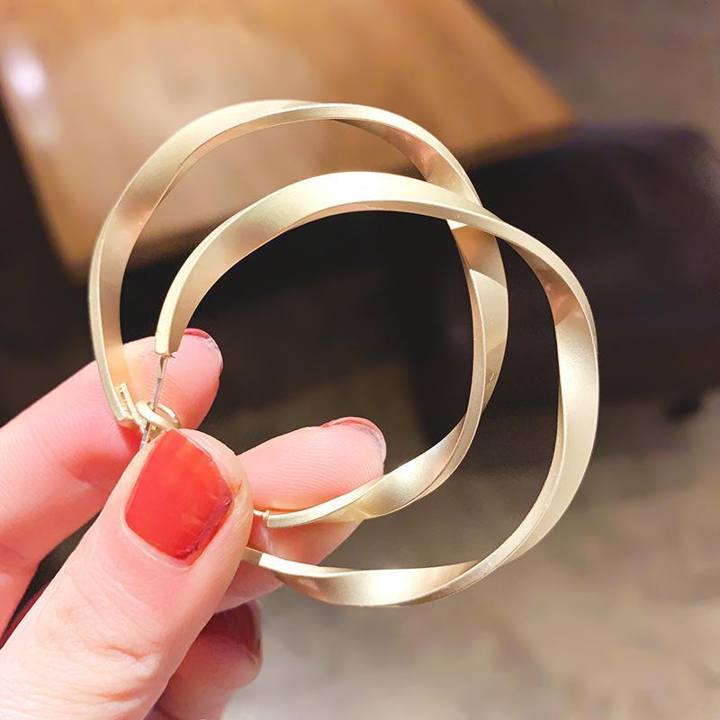 S925 geometría de metal aguja pendientes Europea y temperamento ronda pendientes de aro cuadrados estadounidenses para las mujeres de la joyería del regalo del partido