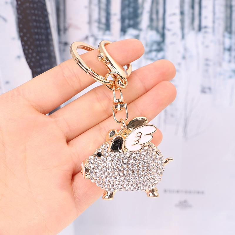 Llaveros Moda Mujer Muchacha Coche Anillo Anillo Rhinestone Incrustado Flying Pig Llavero Tenedor de metal Decoración Colgante Regalo Joyería