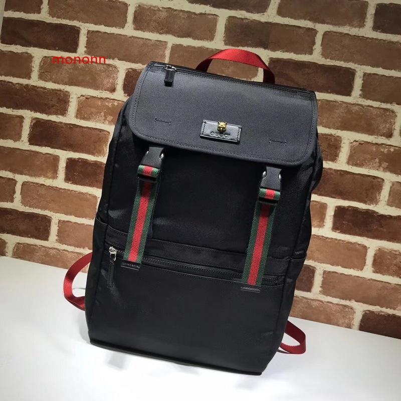 De calidad superior 2020 del cuero diseño de la celebridad de la letra en relieve de la raya de la correa Negro Mochila de lona mujer del hombre 450982 bolsa de viaje