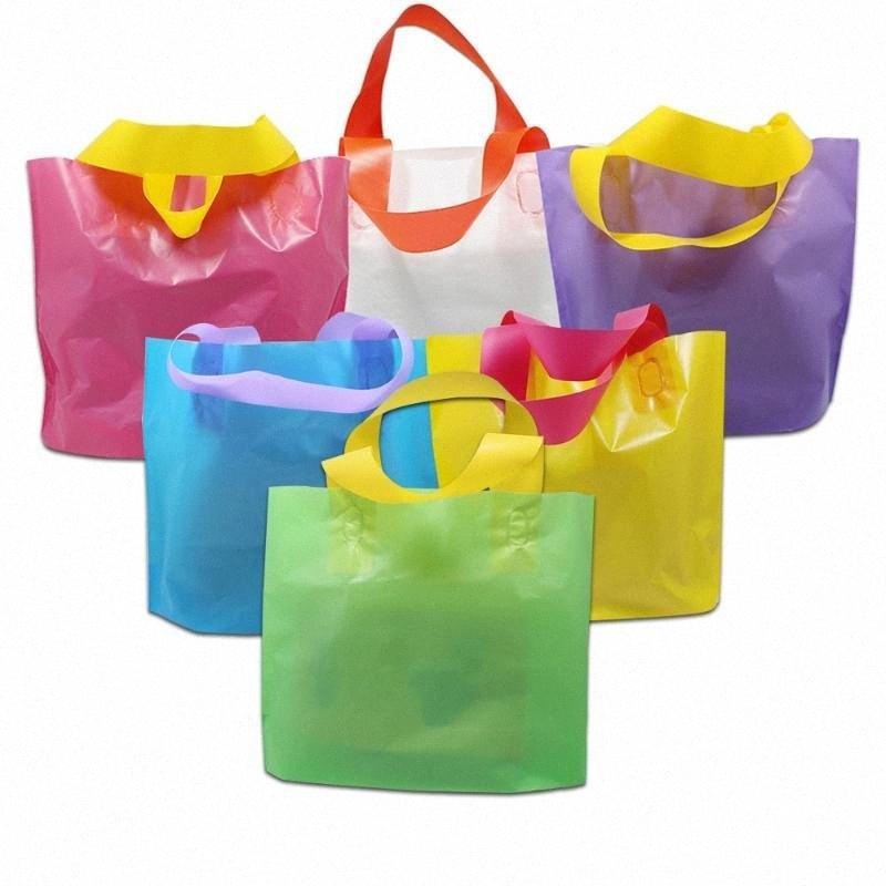 100pcs plástico colorido saco de compras com punho reutilizáveis Roupa presente Grocery Boutique Embalagens Grande 35 * 25 centímetros 4 Tamanho 6 cores rRCO #