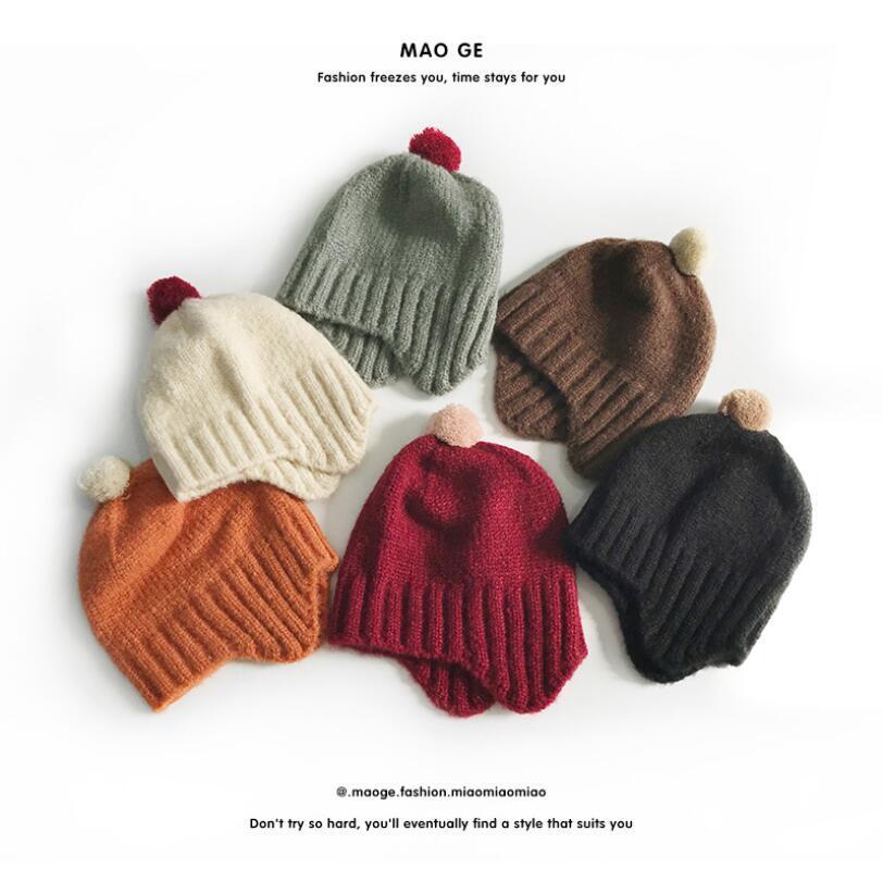 I bambini di lana Moda Cappelli Crochet maglia Filati cappelli del bambino Earflaps sfera Top decorazioni Cap bambino appena nato Berretti inverno caldo Cappelli LSK973