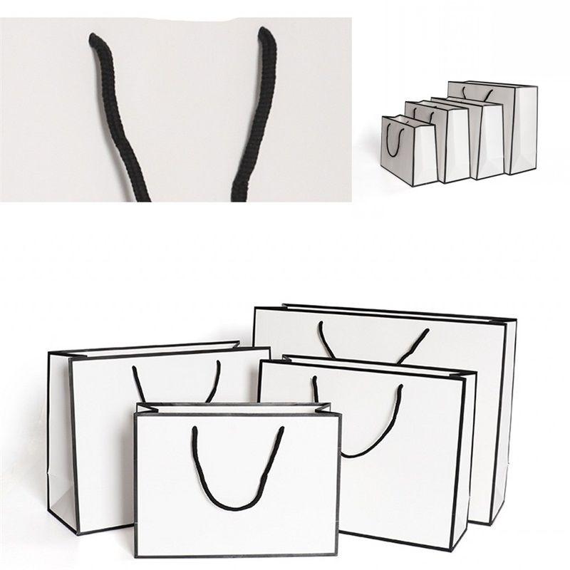 Papier kraft Thicken Sacs Carte blanche Emballage Sac Publicité Mode de stockage Sac shopping personnalisé Party Vêtements 1 86gr B2