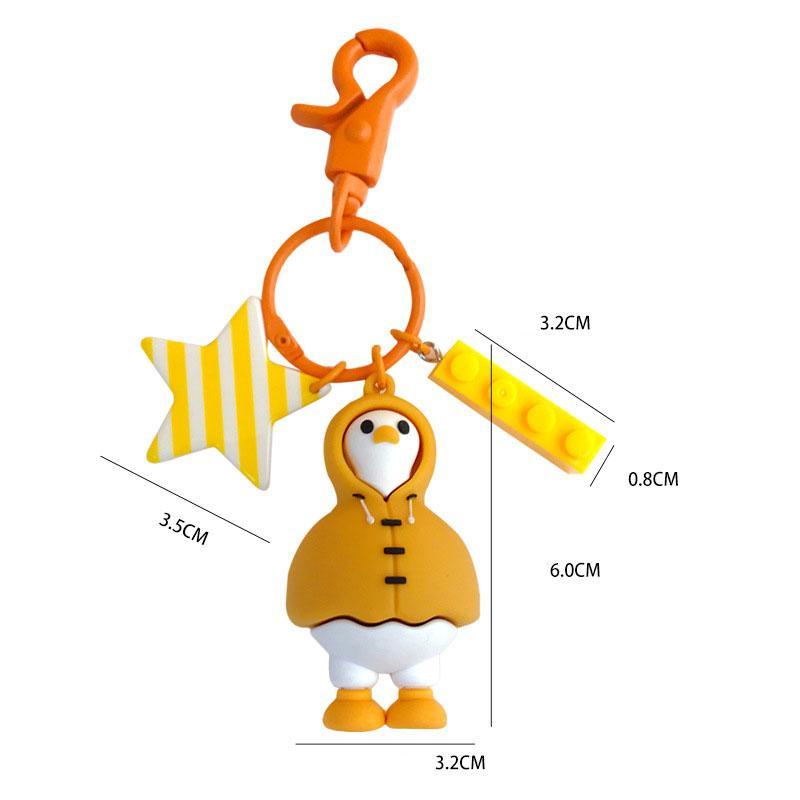 Venta caliente creativo personalizado de dibujos animados de PVC blando suéter pato llavero Ins Tendencia cadena dominante del coche
