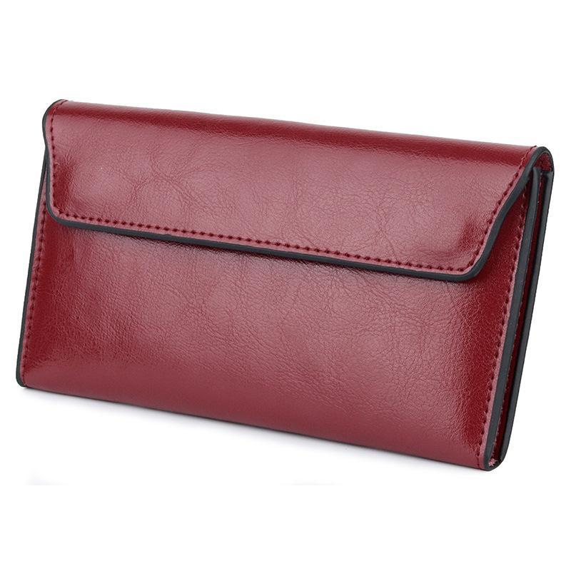 Embrayage nouvelle mode véritable cuir femme portefeuille longue femme de vachette de vachette porte portefeuille multiples sacs à main Standard marque UGPKC