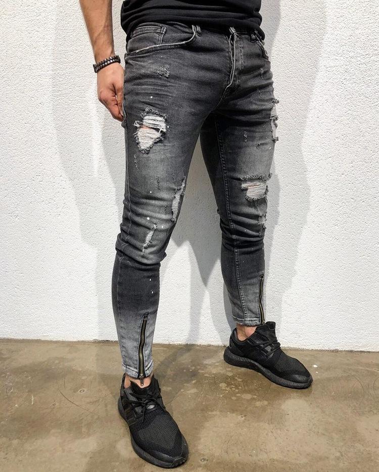 Neue Männer modisches Loch-Piercing und Reißverschluss Jeans Bein Jugend Abnutzung Reißverschluss Abnutzungsjeans NK52 llSwM kleine Füße der Männer strecken