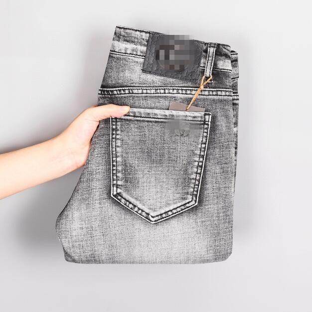 Jeans für Männer Herbst / Winter-Mode Herrenhosen abnehmend kleine Füße vielseitige Hose Frühling / Herbst / Winter beliebt Logo