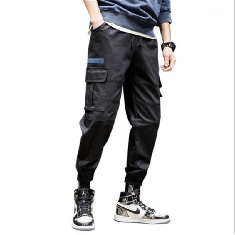 Брюки Карманы Повседневный Сыпучие Solid Color Pencil мужские кальсоны способа Street Style Мужские дизайнерские брюки Карго