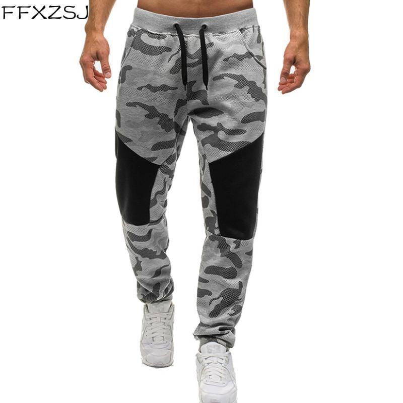 Los hombres nuevos pies de camuflaje pantalones casuales pantalones pantalones de costura hombres de personalidad movimiento lápiz de los pantalones ocasionales elásticos de la cintura