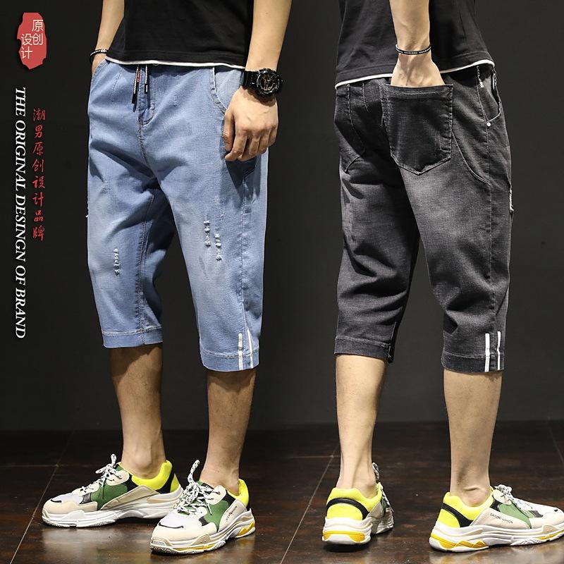 Verano delgada rasgado recortada pantalones cortos de mezclilla gran tamaño de los hombres Nueve nueve cortos los pantalones hasta los tobillos moda jóvenes de alto elástica recortada negro con cordones