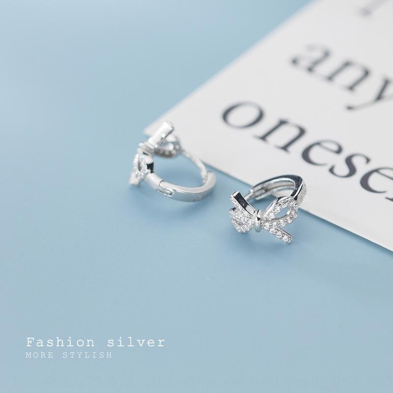 Japonesa de 70hNu Loch s925 earwomen plata y el pendiente del corazón del estilo inconformista coreana mariposa completo de la chica de moda arco de diamantes pendientes de diamantes