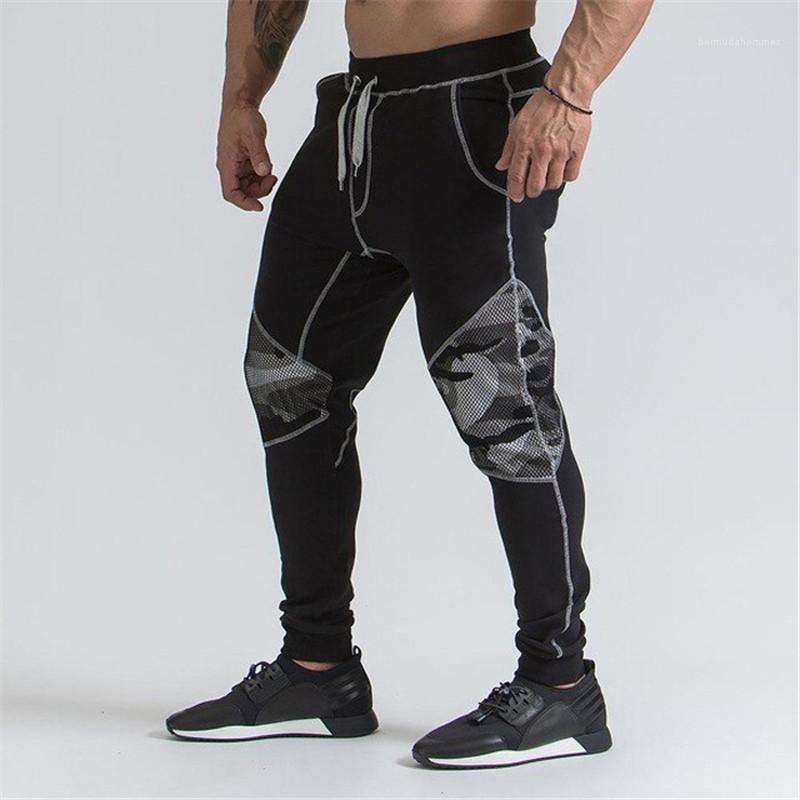Pantalones remiendo del camuflaje del color sólido Pantalones Lápiz mediados de cintura de los pantalones masculinos activos Ropa para hombre de malla diseñador