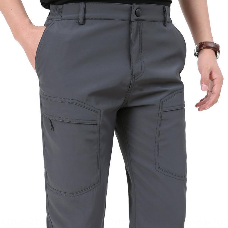 La primavera y el otoño al aire libre deportes guardapolvos pantalones nuevos de secado rápido ocasionales deportes al aire libre de los hombres de los pantalones de Rush impermeables y transpirables de múltiples bolsa