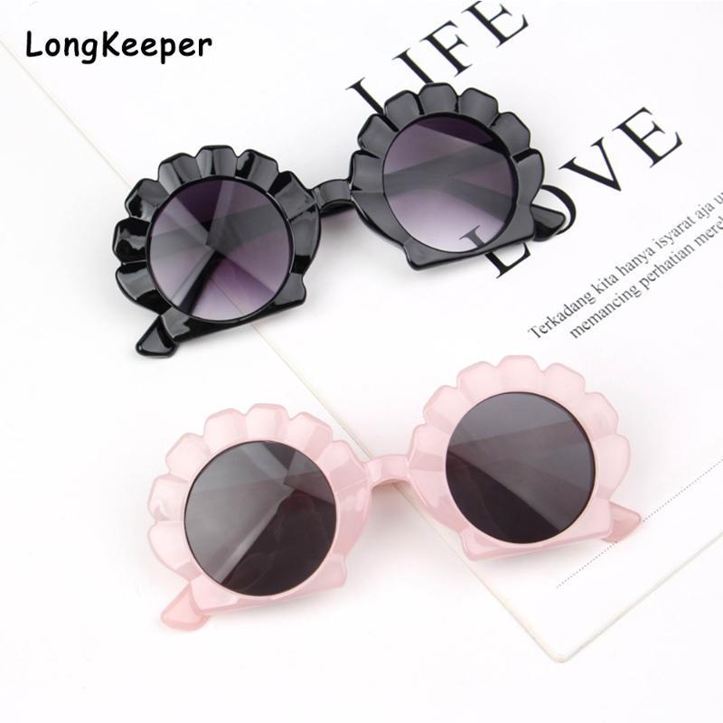 2020 niños Gafas de sol redondas niños de la manera linda forma de la flor de Shell Ripple gafas de sol UV400 muchachos de las niñas bebé de regalo rosado Gafas