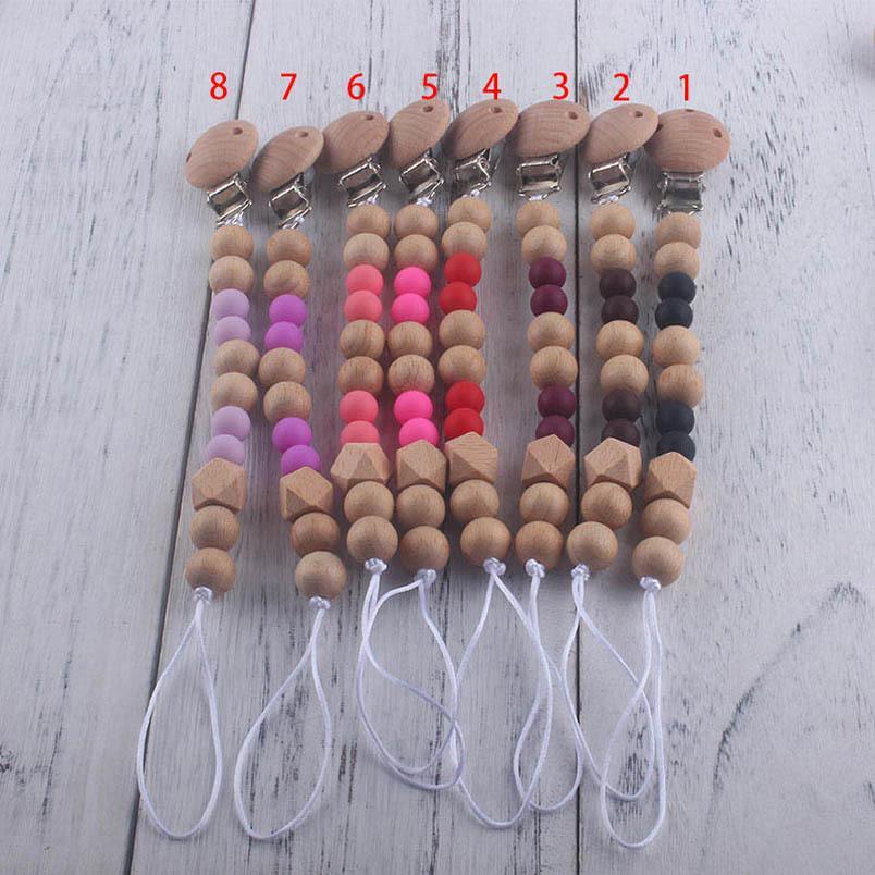 Nuevo llegó clips de cadena de bolas de madera del bebé Chupete con la cubierta caliente de Comercio Exterior Venta infantil hecha a mano natural Clemente Chupete titular B1831