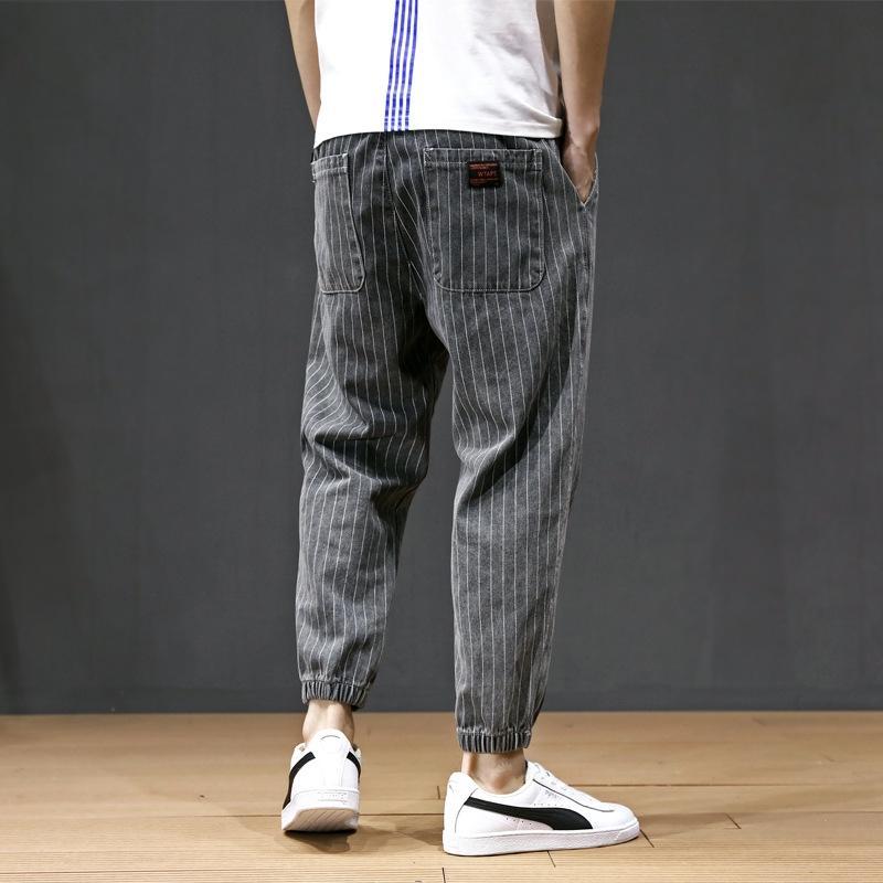 Pantalon serré à la mode et un jean tout nouveau lacé sarouel de jean à rayures taille élastique hommes jeunes, plus lâches jambières de graisse, plus la taille