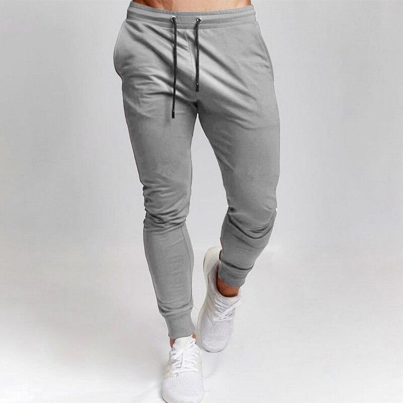 UEFEZO deporte de los hombres de ocio Pantalones Solid Versátil color Ejecución de entrenamiento de la aptitud Pantalones con cordones sólidos pantalones Versátil aptitud