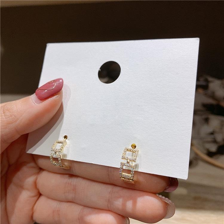 Südkorea Diamant und East Gate 925 silberne Nadel-Flash-Diamant-Platz Hohl aus Metall Ohrring kleinen und exquisite Ohrringe Mikro-Intarsien