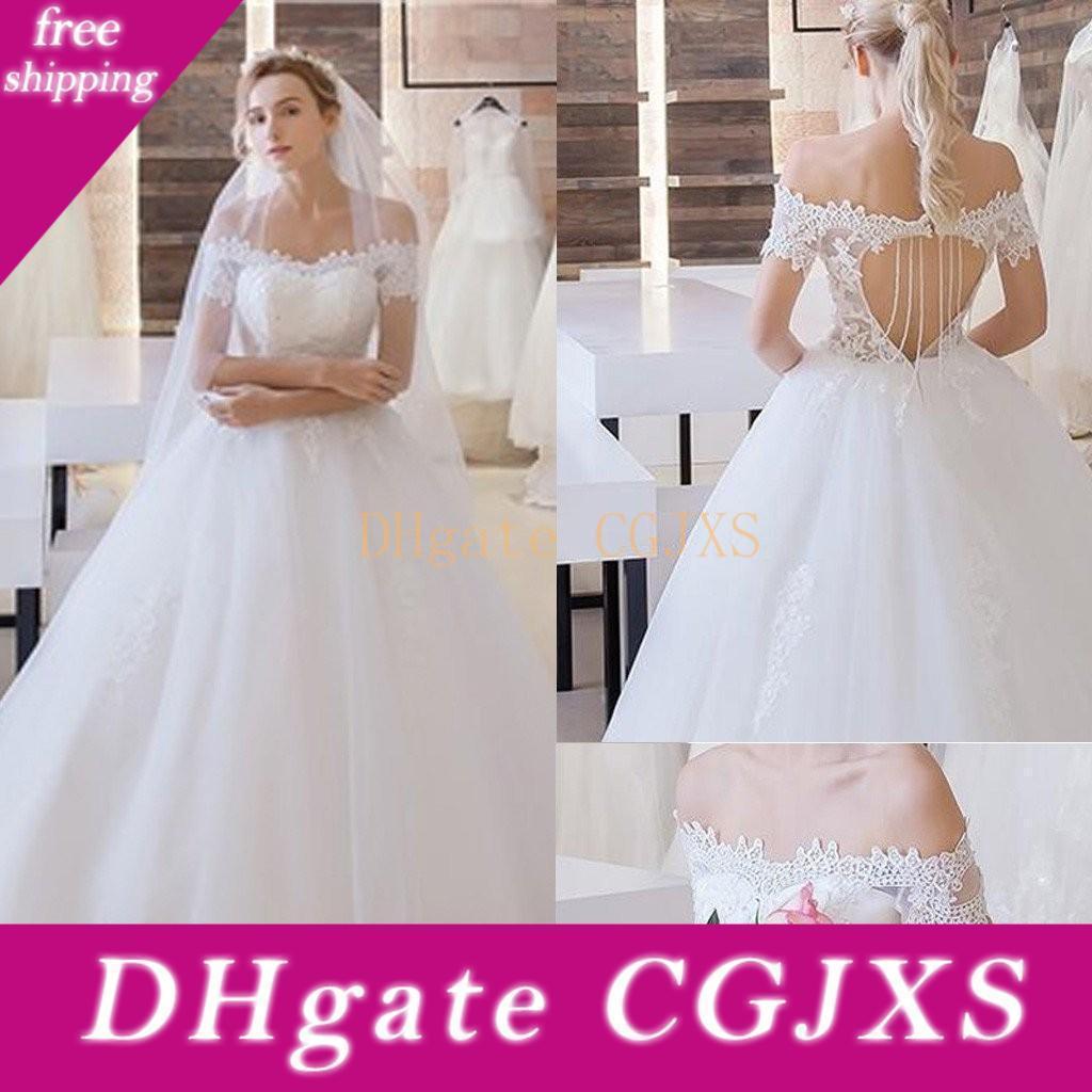 Western White Lace Vestidos de casamento com apliques 2019 Alças oco Voltar manga curta Andar de comprimento vestidos de noiva personalizado