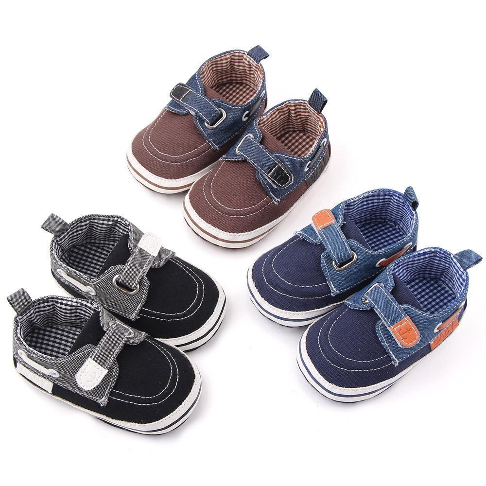 Nueva moda zapatillas de deporte del bebé recién nacido Sole zapatos suaves calzado infantil del pesebre del niño de las zapatillas de deporte mocasines de 1 año para caminar