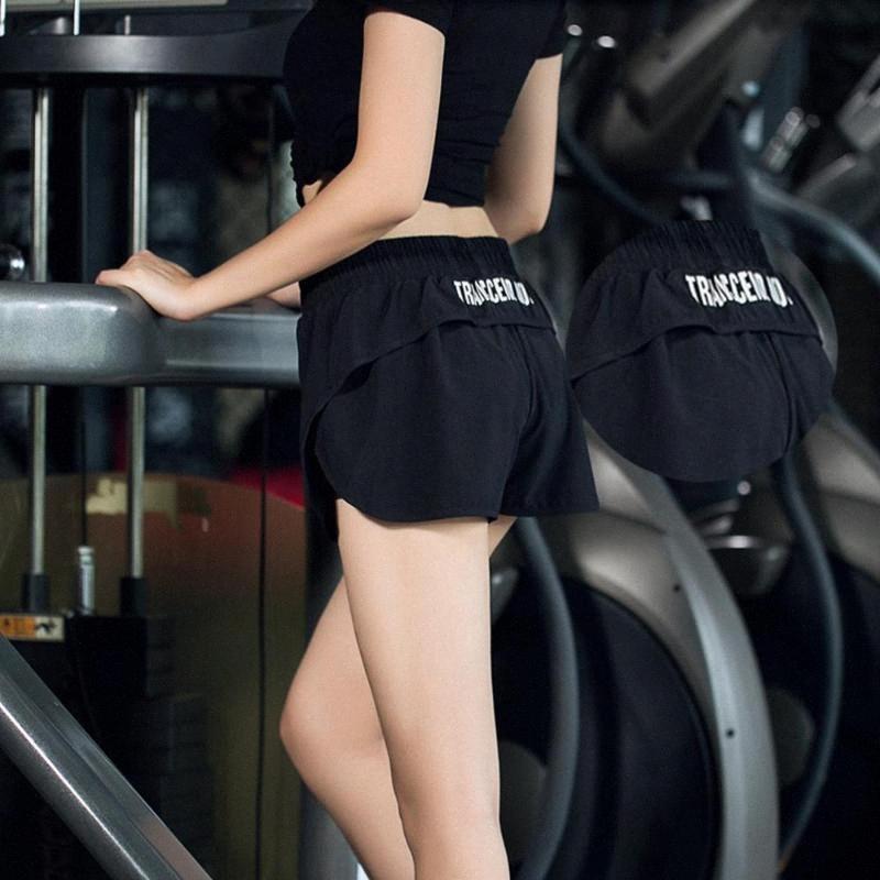 les femmes de la mode Gym short de yoga avec des poches taille haute Tight respirant leggings sport Casual courte Pq1n #