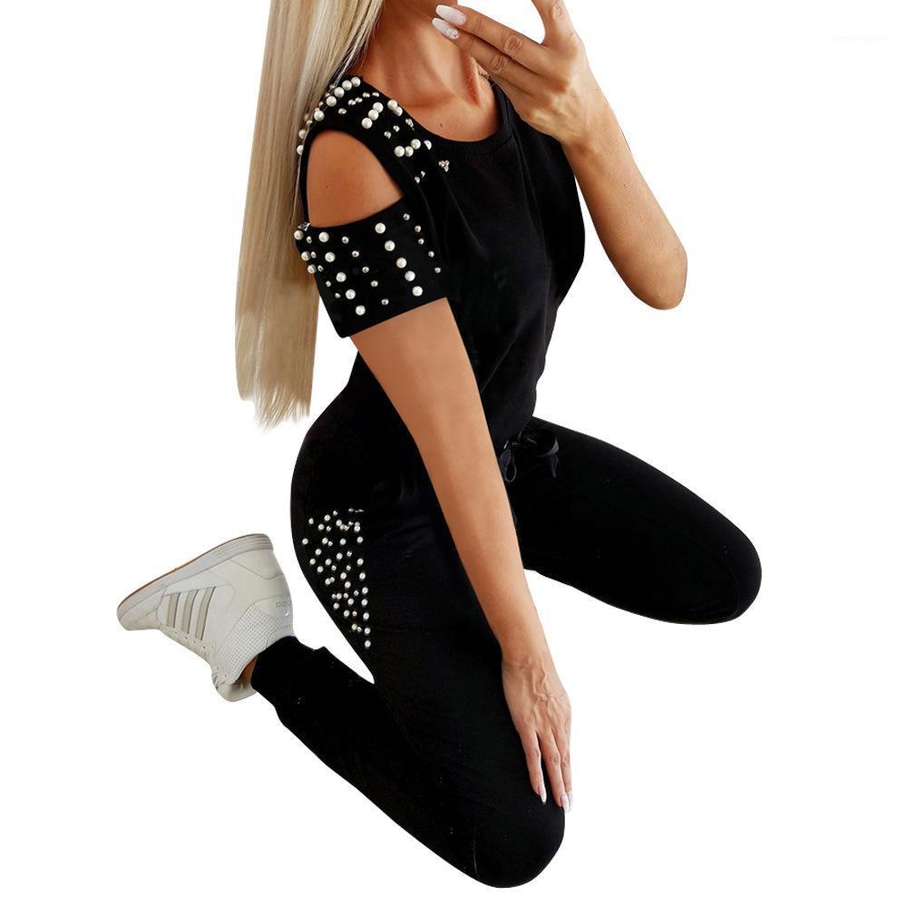 A cabo juegos delgados Mujer del verano 2pcs Sólido Color Establece las mujeres atractivas de la manera ropa de las mujeres hueco de la perla