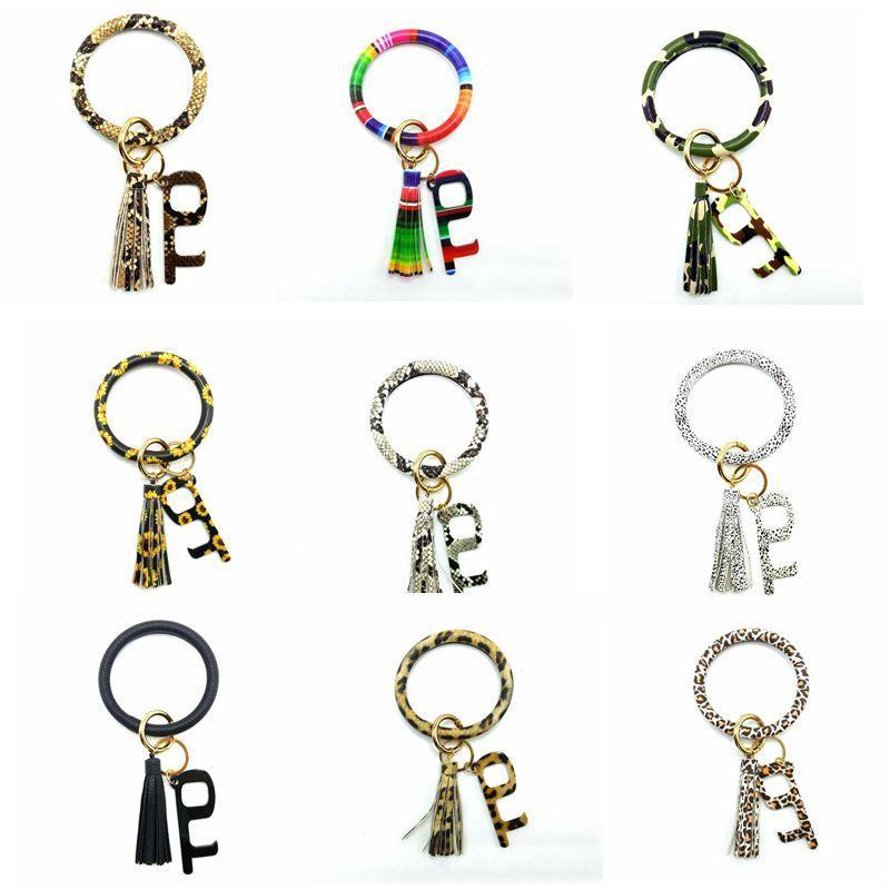 سلسلة سوار مفتاح PU جلدية الشرابة السوار سلاسل المفاتيح العامة عدم الاتصال مصعد زر سوار سوار اقية أداة رئيسية سلسلة DHB970